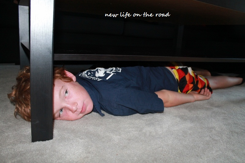 Kyle watches TV while laying under the coffee table!!