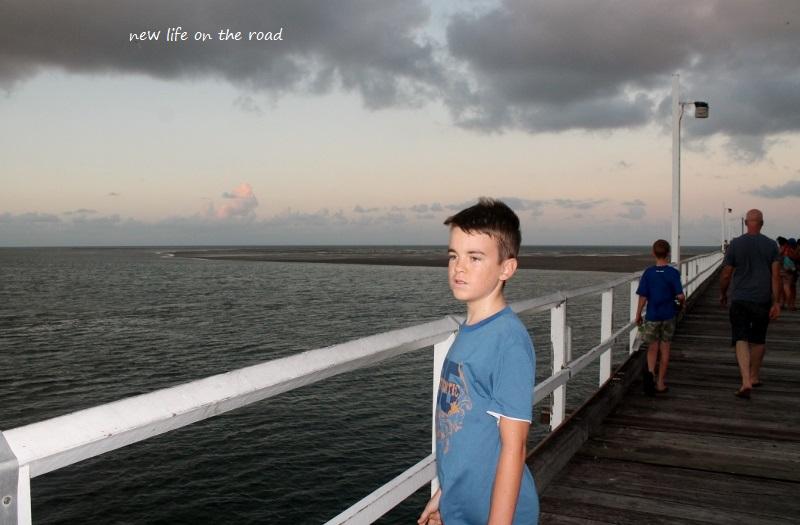 Cameron walking across the Pier