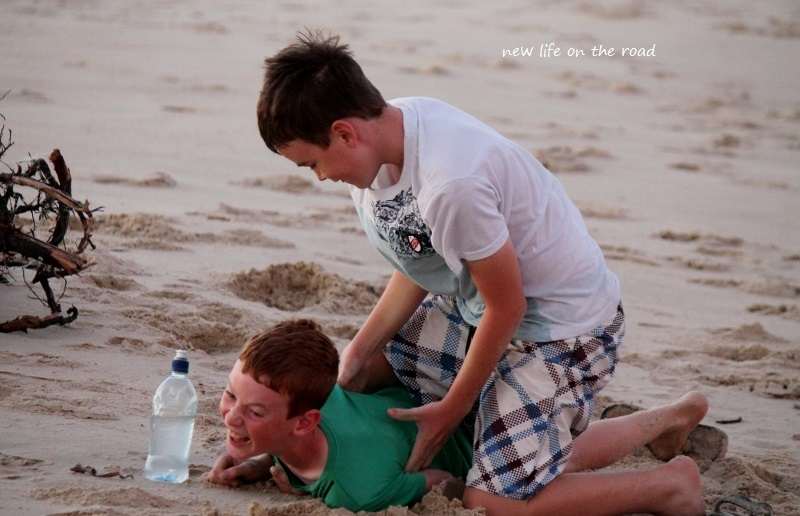 Cameron and Kyle tickling each other