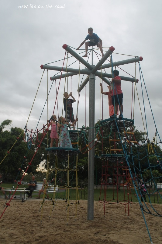 Climbing up high on the Playground Equipment