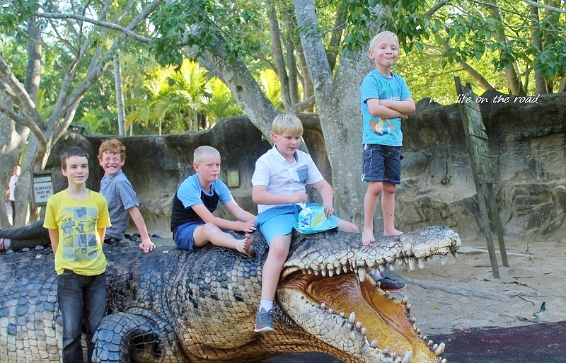 our boys and friends sitting on the big croc